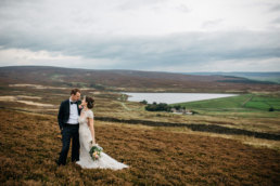 Bride and Groom posing in the moors on their wedding day, craigmar weddings yorkshire wedding photographer