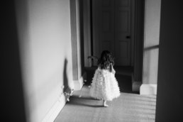 Flower girl walking among the halls at Saltmarsh hall