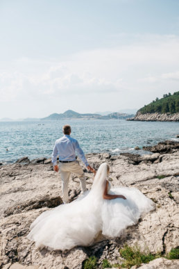 Bride and groom looking out to sea on Lokrum island Croatia