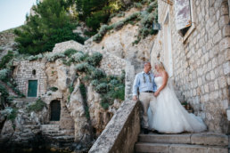 Couple posing on the steps at Dubrovnik wedding photographer, destination wedding photographer