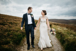 Bride and Groom walking through the moors in Yorkshire