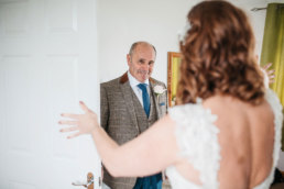 Father of the bride seeing his daughter on her wedding day