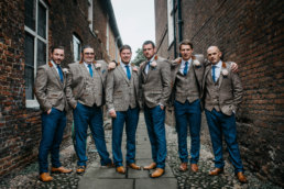 Groomsmen posing for a group photo