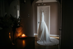 Wedding dress hanging in the hallway at Scotish wedding