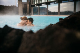 Couple swimming in the blue lagoon iceland