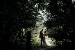 Bride and Groom posing among the trees at Lincolnshire wedding venue Healing Manor