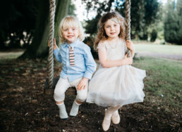Bride and Grooms children posing on the swing at Cleatham Hall wedding venue lincolnshire