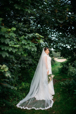 Bride posing among the trees at Healing manor