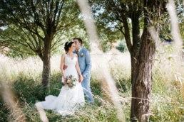 Bride and Groom posing in the gardens at Elsham Hall wedding venue