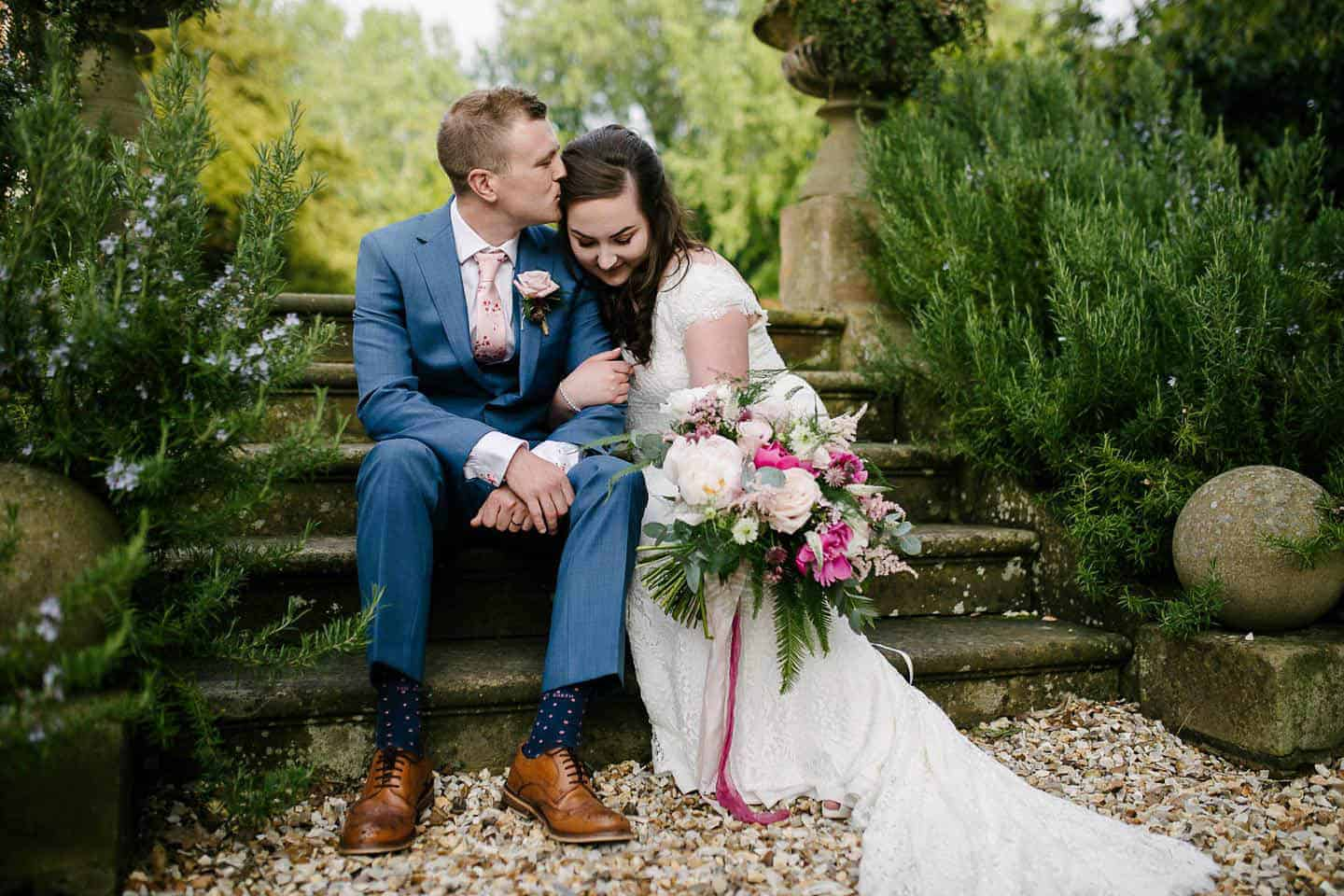 Beautiful couple on the footsteps at Hirst Priory near Crowle on their wedding day
