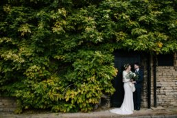 Couple pose under the Wisteria at George hotel