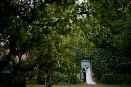 In the secret garden on your wedding day at Elsham hall